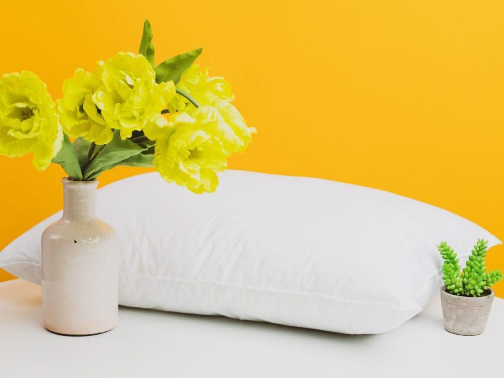 yellow flower in white ceramic vase
