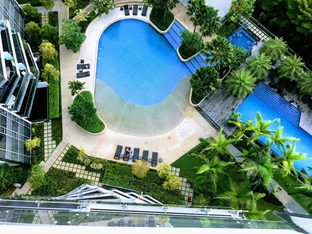 aerial photography of pools outside buildings